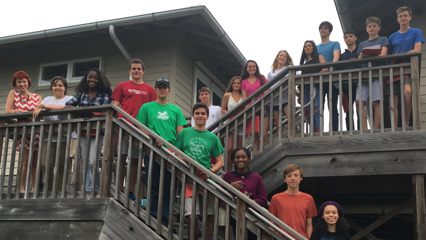 Teen Writers Workshops participants posing on a staircase